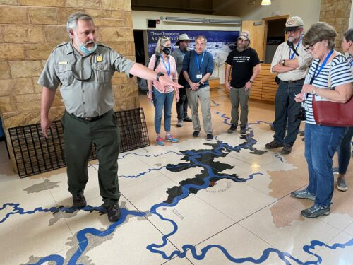 A national park ranger points out the nine rivers that make up the New River water basin. The entire floor of the information center near Hinton is a giant map of the river basins.