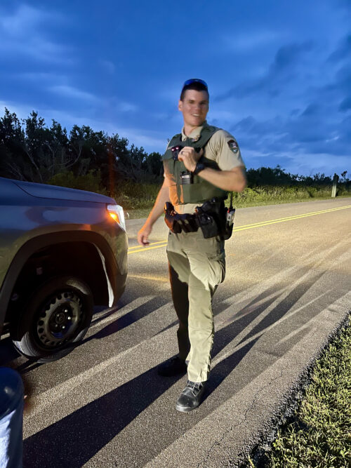 Merritt Island National Wildlife Rufuges' Ranger Goss proved to be a good sport during our traffic stop, helping to change our flat tire