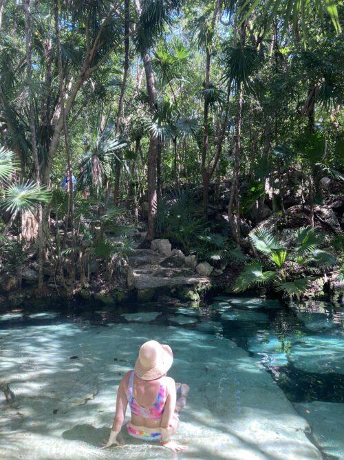 Alyssa Pinsker in a cenote, the Cenote Azul, in Tulum