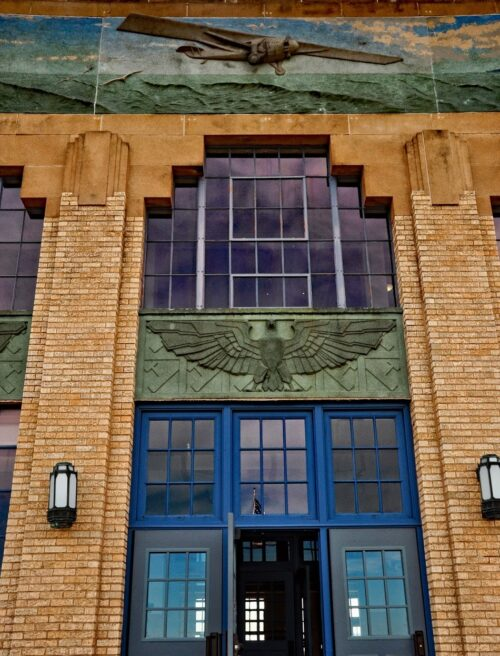 The Kansas Aviation Museum occupies the Art Deco terminal of the former Wichita Municipal Airport. A bas-relief of Charles Lindbergh's Spirit of St. Louis appears above the entrance.