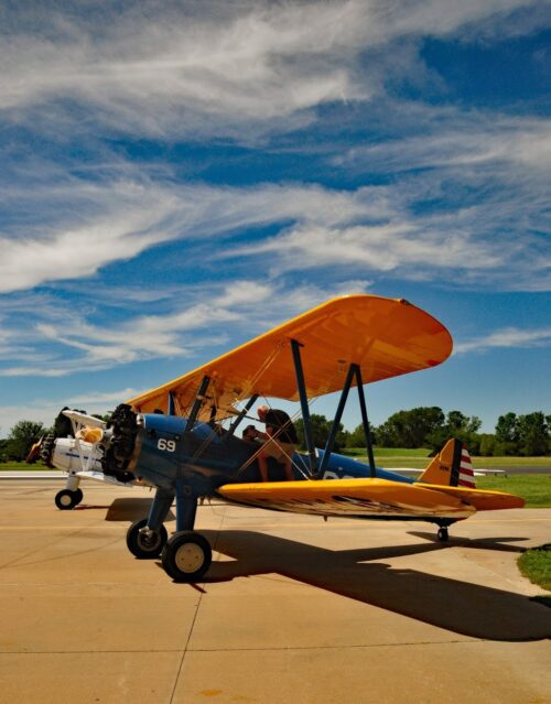 Biplanes sit outside Stearman Field Bar & Grill after taking visitors up for a flight.