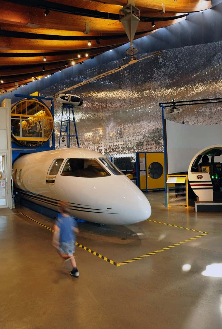 """Visitors learn how aircraft are built at the """"Design Build Fly"""" exhibit at Exploration Place science center."""