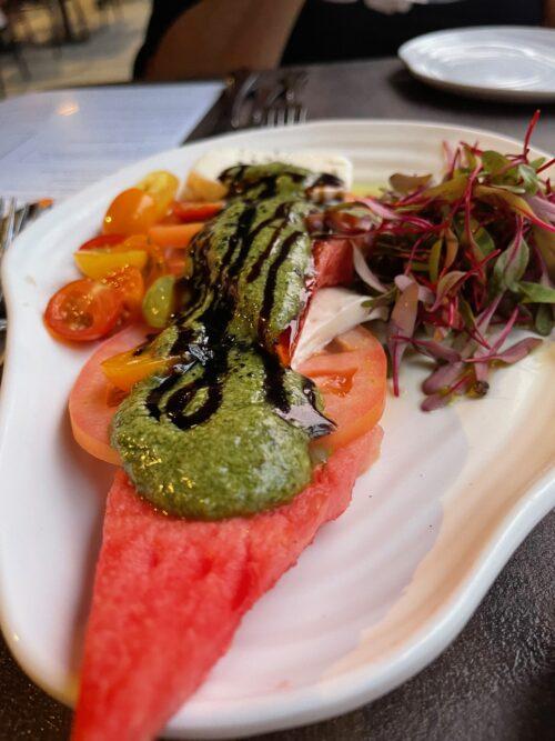 Heirloom tomatoes with pesto on watermelon at Diamond's Edge Restaurant, Portland Maine.