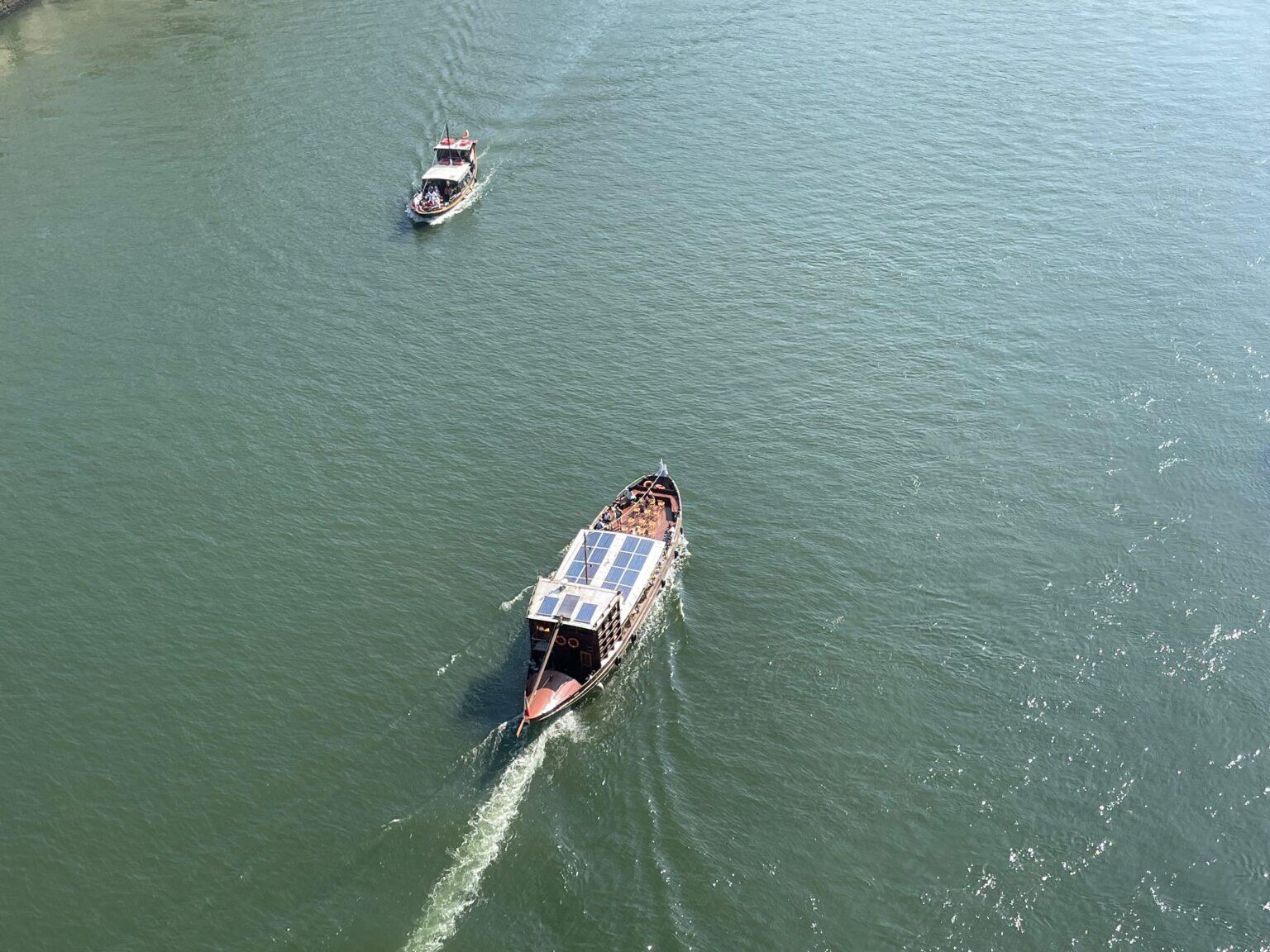 A local day cruise trip boat in Porto under the big bridge, Dom Luis I.