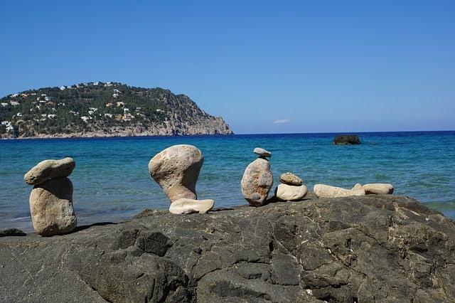 Stones adorn the beach in beautiful Ibiza, Spain.