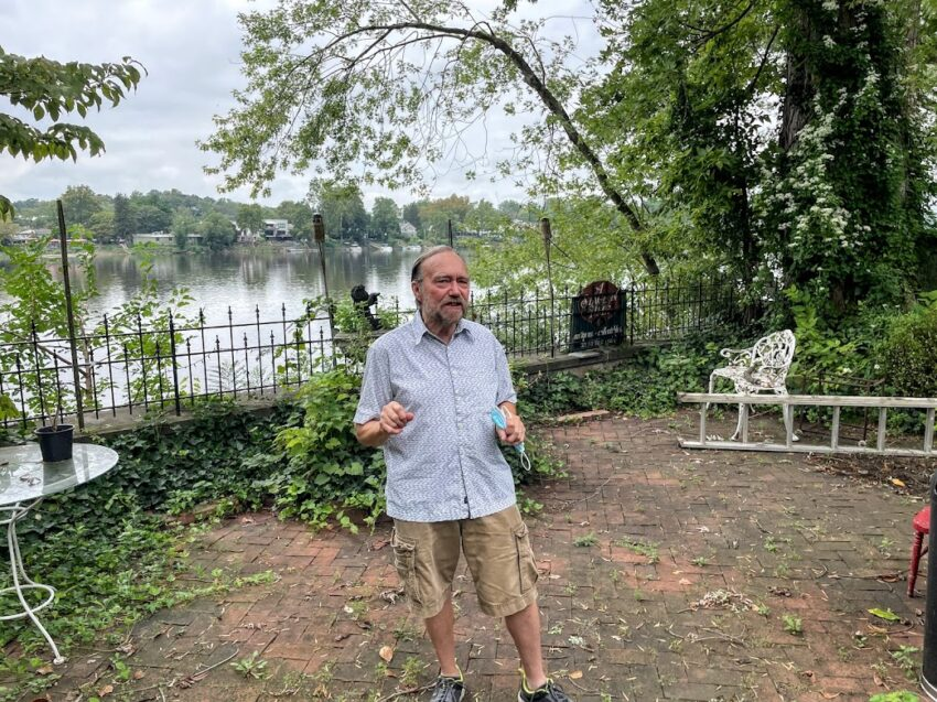 Peter Prorok stands outside his art and antiques gallery along the Delaware River in Lambertville