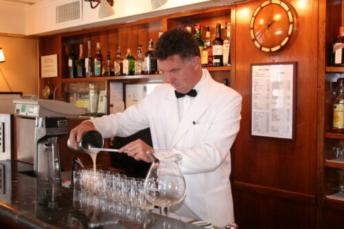 A 'Bellini' cocktail being mixed at Harry's Bar