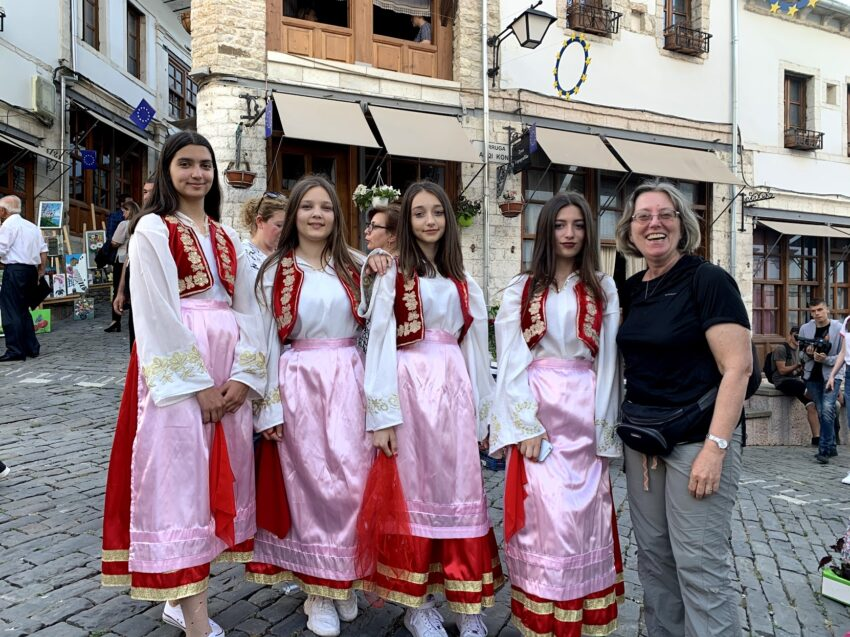 Jayne with a group of teenage Albanian folk dancers at a festival in Gjirokaster, Albania.